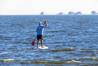 Man Paddleboarding on Carrabelle Beach