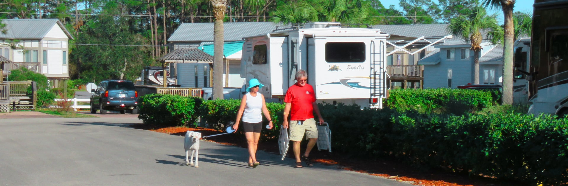 Couple Walking Dog at Carrabelle Beach RV Resort