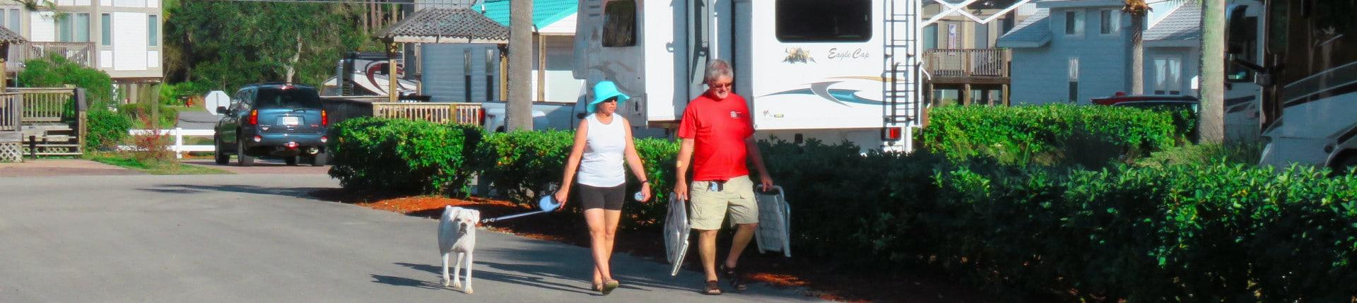 Couple Walking Dog at Carrabelle Beach RV Resort